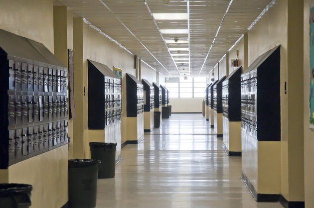 A high school hallway lined with lockers Pat Canova via Getty Images