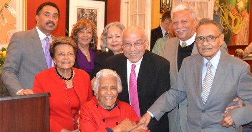 "Chef Leah Chase (seated center) and husband Edgar ""Dooky"" Chase Jr. (far right), surrounded by friends including former 1st Lady Sybil Morial (l); Mr. & Mrs. Ronnie Burns (President & CEO QCS Logistics); Mr. & Mrs. Norman Francis (Xavier Univ. President Emeritus); and Mr. & Mrs. Alden McDonald (President & CEO, Liberty Bank) as they celebrate both Leah Chase's 93rd birthday and the 75th anniversary of Dooky Chase's Restaurant Photo credit: Vincent Sylvain"