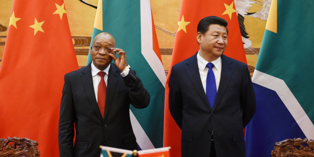 South African President Jacob Zuma (L) and Chinese President Xi Jinping (R) attend a signing ceremony at the Great Hall of the People in Beijing, December 4, 2014. REUTERS/Wang Zhao/Pool (CHINA - Tags: POLITICS)