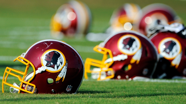 In this June 17, 2014, file photo, Washington Redskins helmets sit on the field during an NFL football minicamp in Ashburn, Va. (AP Photo/Nick Wass, File)