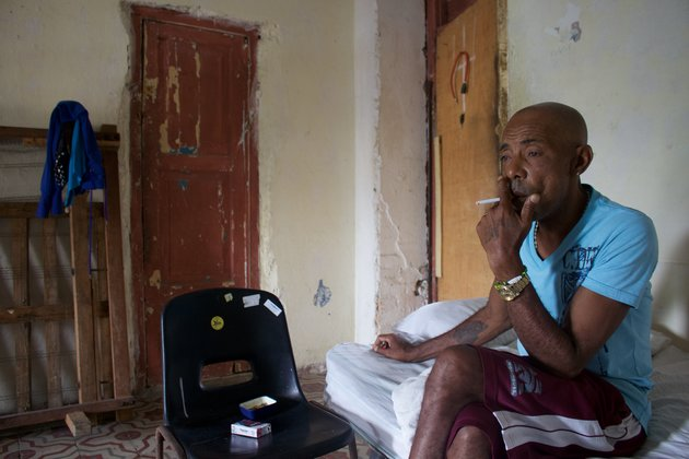 Francisco Jesús Jiménez, 58, smokes a cigarette in his apartment in the working-class neighborhood of Cayo Hueso, Havana. He is one of only about 2,200 Cubans to be deported from the U.S. since 1980.