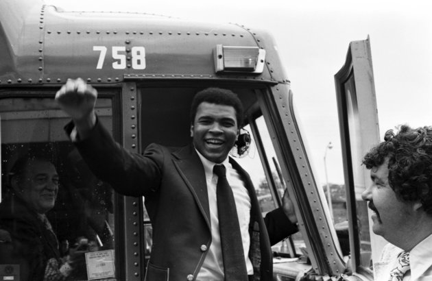 NEW YORK - SEPTEMBER 1973: Muhammad Ali waves to fans during a bus tour to promote his upcoming second fight against Ken Norton in September, 1973 in New York, New York. (Photo by: The Ring Magazine/Getty Images)
