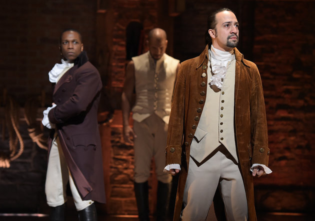 "NEW YORK, NY - FEBRUARY 15:  Actor Leslie Odom, Jr. (L)  and actor, composer Lin-Manuel Miranda (R) perform on stage during ""Hamilton"" GRAMMY performance for The 58th GRAMMY Awards at Richard Rodgers Theater on February 15, 2016 in New York City.  (Photo by Theo Wargo/WireImage)"