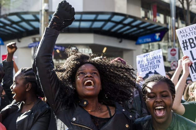 MELBOURNE, AUSTRALIA - JULY 17 : Protestors hold banners and chant slogans during a Black Lives matter rally in Melbourne, Australia on July 17, 2016. Approximately 3500 protestors rallied in Melbourne to show 'solidarity' after racial violence in US. (Photo by Asanka Brendon Ratnayake/Anadolu Agency/Getty Images)