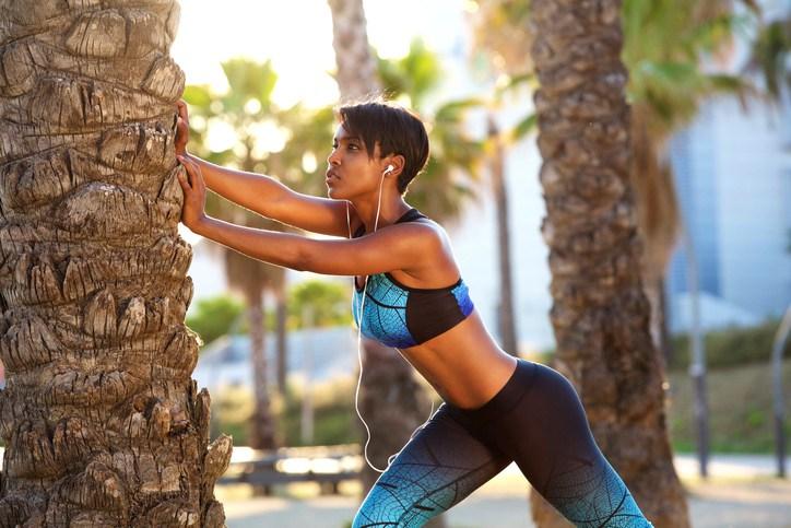Beautiful black woman stretching workout routine