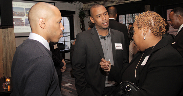 Will Moss (center), founder of HBCU Connect, networking with attendees to his company's event