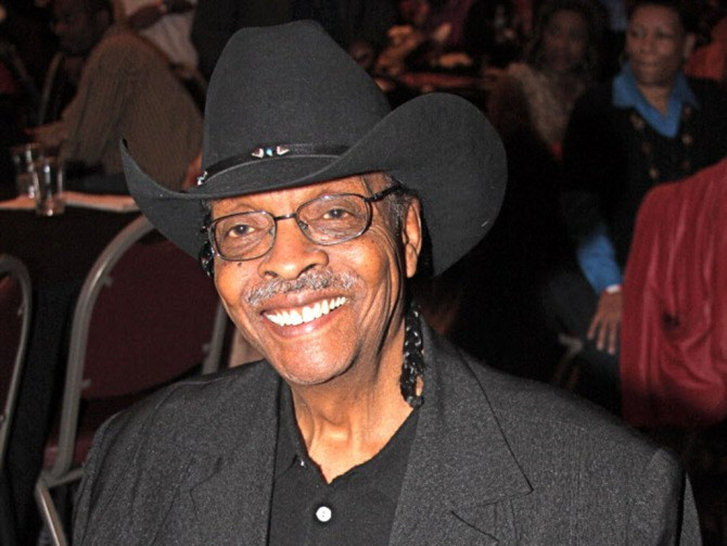 """2-23-2009 Handout photo: Herb Kent with his new autobiography """"Cool Gent"""", taken friday at the south shore cultural center's book fair.(photo by Ken Bedford)"""