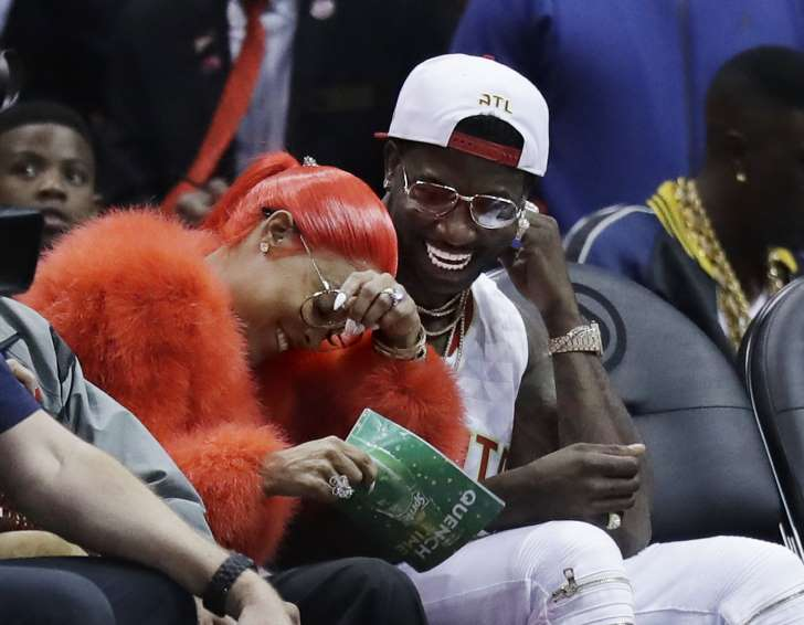 The Associated Press Hip Hop artist Gucci Mane, right, laughs with Keyshia Ka'oir after he proposed to her in the fourth quarter of an NBA basketball game between the Atlanta Hawks and the New Orleans Pelicans in Atlanta, Tuesday, Nov. 22…