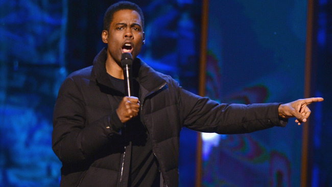 Chris Rock performs on stage at Comedy Central Night Of Too Many Stars at Beacon Theatre on February 28, 2015 in New York City. (Photo by Stephen Lovekin/Getty Images for Comedy Central).