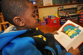 A student at MPS' 81st Street School reading a Dr. Seuss book