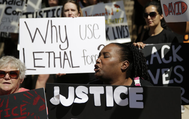 Protesters attend a rally at Austin City Hall in response to the recent fatal police shooting of David Joseph, 17, Thursday, Feb. 11, 2016, in Austin, Texas. The shooting of Joseph, who was naked and unarmed, has provoked outcry among social justice activist groups. (AP Photo/Eric Gay)