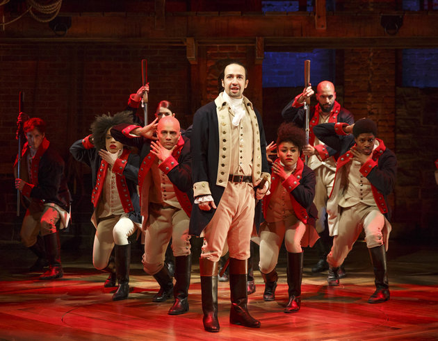 "This image released by The Public Theater shows Lin-Manuel Miranda, foreground, with the cast during a performance of ""Hamilton,"" in New York. ""Hamilton,"" the hip-hop stage biography of Alexander Hamilton won the 2016 Pulitzer Prize for drama on Monday, April 18, 2016. (Joan Marcus/The Public Theater via AP)"