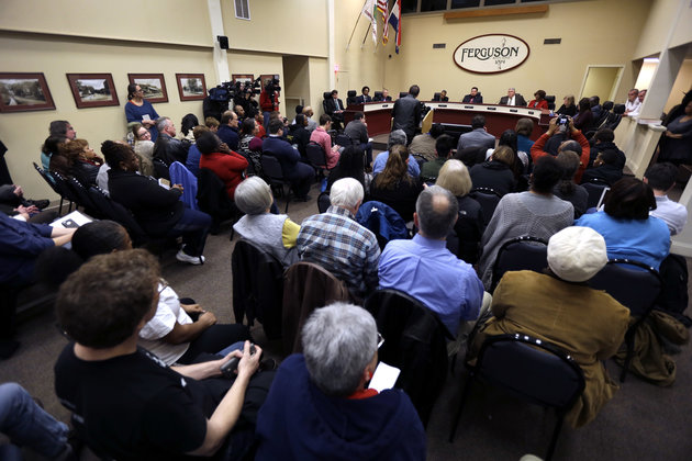 Ferguson residents pack the council chambers for a meeting of the City Council Tuesday, Feb. 2, 2016, in Ferguson, Mo. City leaders have spent months negotiating a settlement with the U.S. Department of Justice, a plan that calls for sweeping changes to police practices in the St. Louis suburb where 18-year-old Michael Brown was fatally shot. (AP Photo/Jeff Roberson)