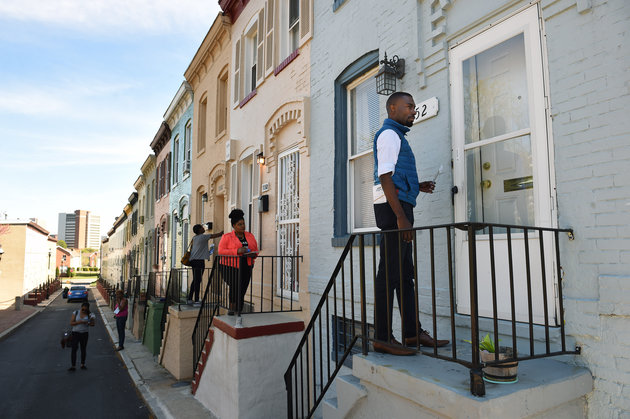 BALTIMORE, MD- APRIL 20: Candidate for mayor, DeRay Mckesson knocks on doors to meet potential voters on Wednesday April 20, 2016 in Baltimore, MD. The city saw unrest following the death of Freddie Gray last year. There is a mayor's race this year in the city. (Photo by Matt McClain/ The Washington Post via Getty Images)