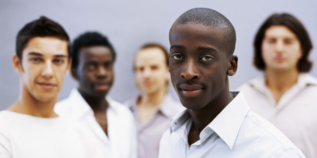 portrait of five young men standing together