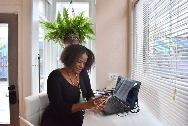 Dr. Dionne Mahaffey uses the WhereU application she created to help identify black-owned businesses. So far, she has about 70,000 businesses on the app. HYOSUB SHIN / HSHIN@AJC.COM