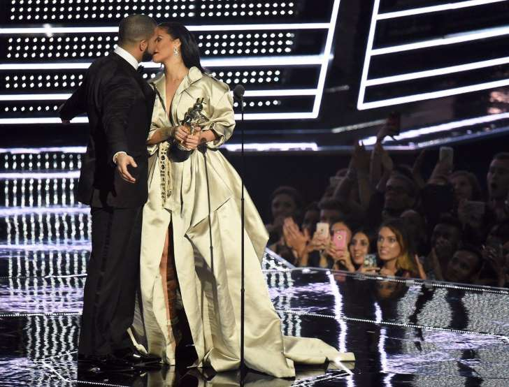 Provided by New York Daily News Drake presents Rihanna with the The Video Vanguard Award during the 2016 MTV Video Music Awards at Madison Square Garden. - Michael Loccisano/Getty Images
