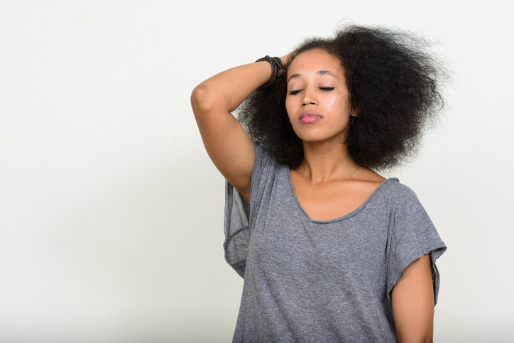 Studio shot of stressed African woman