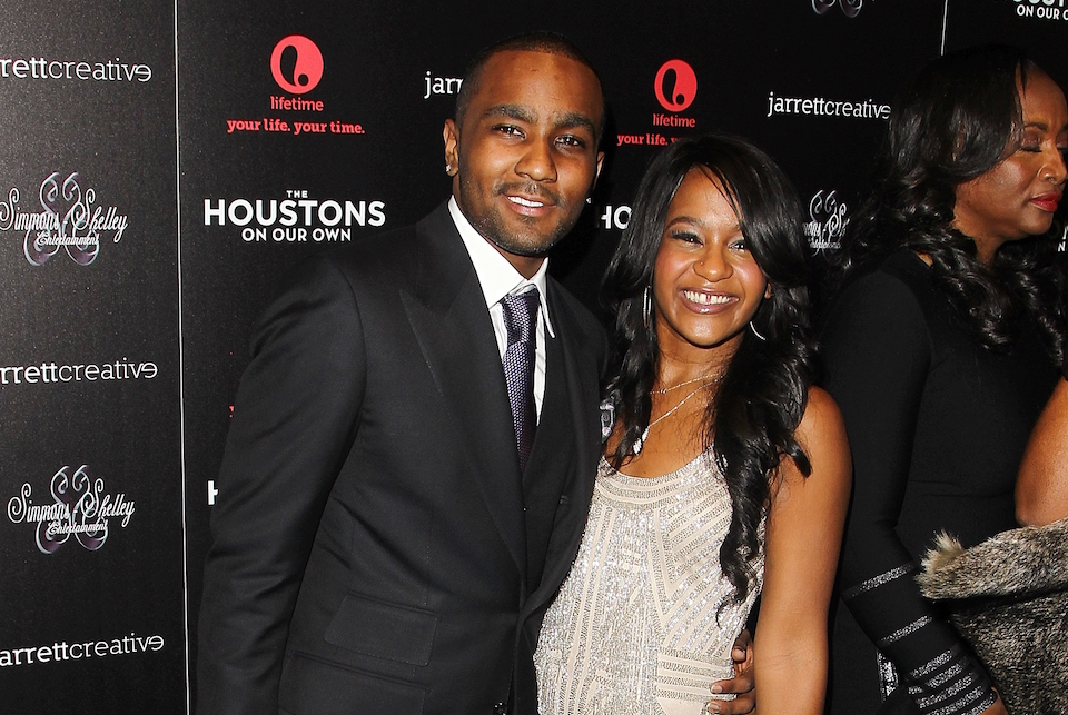 "File- This Oct. 12, 2012 file photo shows Nick Gordon and Bobbi Kristina Brown attending the premiere party for ""The Houstons On Our Own"" at the Tribeca Grand hotel in New York.  A judge in Atlanta on Friday, Sept. 16, 2016,  ruled against Gordon, in a wrongful death lawsuit filed by her estate. Fulton County Superior Court Judge T. Jackson Bedford signed an order saying Gordon repeatedly failed to meet court deadlines in the case and, therefore, the conservator of her estate wins by default.( Photo by Donald Traill/Invision/AP,File)"
