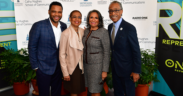 Howard University honored Cathy Hughes, founder and chairperson of Radio One, Inc., with the unveiling of the Cathy Hughes School of Communications Sunday. Pictured L-R: Actor Anthony Anderson, Congresswoman Eleanor Holmes Norton, Hughes, and Activist Rev. Al Sharpton.