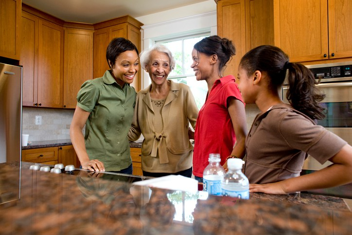 Multigenerational family talking in kitchen